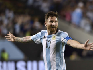 Argentina's Lionel Messi celebrates after scoring a free-kick against Panama during the Copa America Centenario football tournament in Chicago, Illinois, United States, on June 10, 2016.  / AFP PHOTO / OMAR TORRESOMAR TORRES/AFP/Getty Images ORIG FILE ID: 552884563